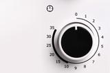 Round analog microwave oven timer, Black icon on white backgroun