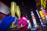 Happy New Year Champagne toast couple in Times Square, New York City