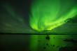 Burning Aurora - The bright fire-shape aurora borealis lit up nightly lake. Yellowknife, NWT, Canada.