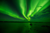 Fototapety Northern Lights Over A Lake - Waves of aurora borealis passing over a lake. Yellowknife, NWT, Canada.
