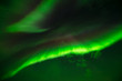 Beaming Down - Layers of bright and colorful aurora borealis beaming down from the starry night sky.