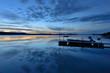 Sunset Lake - The sun sets on an autumn cloudy northern lake. Yellowknife, NWT, Canada.