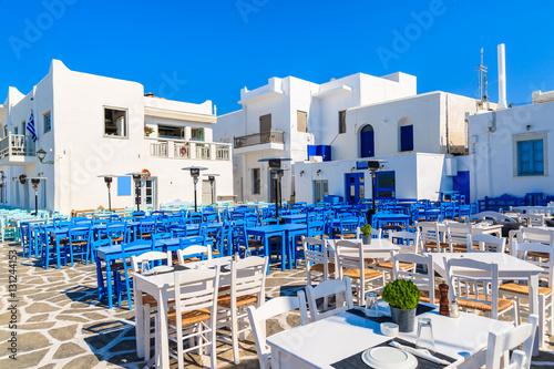 Foto op Canvas White and blue taverna tables on square in Naoussa port, Paros island, Greece
