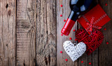 Gift ,  heart and the bottle of red wine for a romantic holiday Valentine