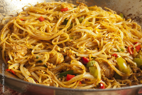 Singapore Curry Noodles in a steel wok Poster