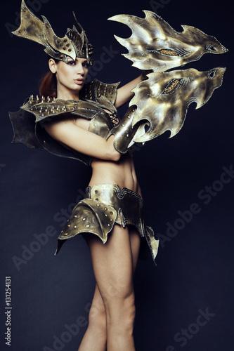 Poster Woman in fantasy metallic armor