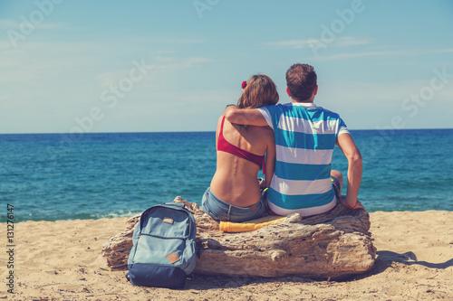 Poster Couple enjoying on the beach.