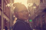 Beautiful woman posing on the street with headphones.