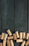 Wine corks on dark wooden texture with copyspace