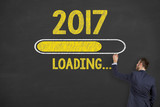 Innovation Concepts Loading New Year 2017 on Blackboard Background