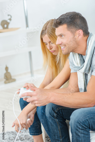 Poster Couple playing computer game, woman losing