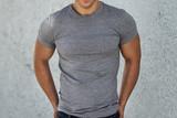 Male casual empty grey clear t-shirt on men`s body.