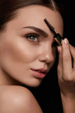 Woman Face With Beautiful Eyebrows And Professional Makeup