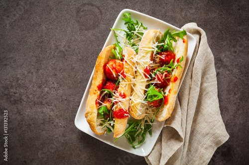 Poster Submarine sandwich meatballs from ricotta cheese on grey stone b