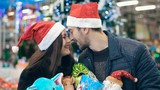 Couple with Christmas presents at store