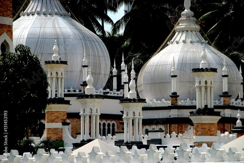 Kuala Lumpur, Malaysia - December 24, 2006: 1909 Masjid Jamek Mosque is a fantasy of white onion domes and minarets designed by noted British architect A Poster