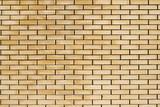High resolution texture of a yellow brick wall. Laying horizonta - 131463998