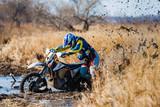 Enduro bike rider stuck in the mud