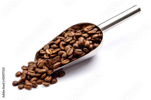Fotobehang Koffiebonen roasted coffee beans in scoop isolated on white background