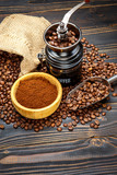 roasted coffee beans on wooden background