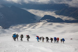A group of alpinists in the snowy storm. Elbrus mountain, Russia