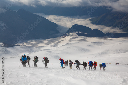 Poster A group of alpinists in the snowy storm. Elbrus mountain, Russia