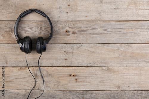 Plakát Headphones on wooden background