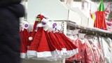 Christmas shopping concept. Santa Claus hats sold in hypermarket