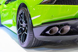 Green car on the white carpet.