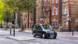Fototapety Black taxi on a london street