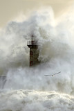 Stormy wave over lighthouse - 131587745