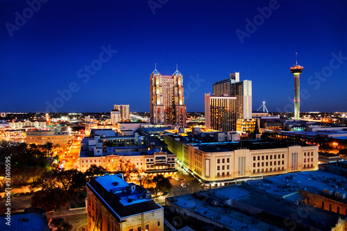San Antonio downtown just after sunset showing skyline around Tower of the Ameri Poster