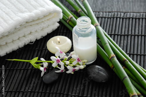 Poster Spa towel and stones and flower ,grove on bamboo mat