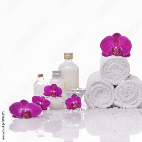 Plexiglas Spa Spa still life with bottle of herbal essenses with orchid,towel