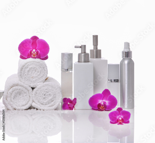 Plexiglas Spa Spa still life with bottle of herbal essenses with orchid