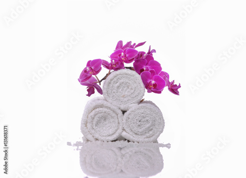 Plexiglas Spa pink orchid on white roller towel