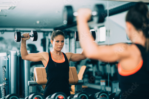 Young woman exercising in the gym