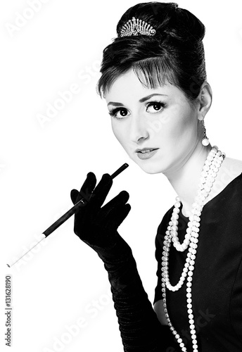 Plakat Portrait of a beautiful young woman in retro style with cigarett