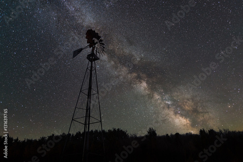Old windmill with the milky way galaxy rising behind it  - 131639765