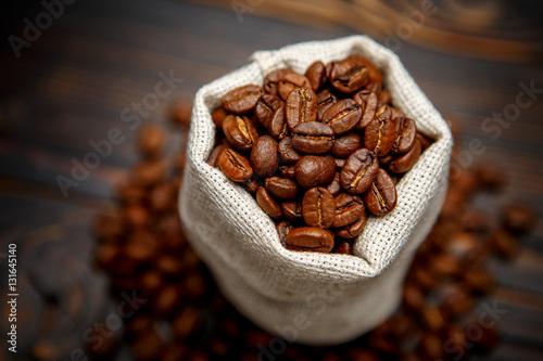 Fotobehang Koffiebonen roasted coffee beans on wooden background