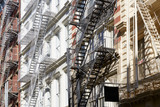 Houses facades with fire escape stairs, sunny day in New York - 131648191