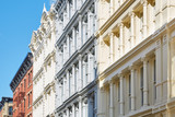 Ancient houses facades in New York, sunny day and blue sky, Soho - 131648980