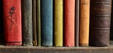 Fototapety Row of colorful vintage books on an old wooden bookshelf