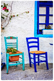 Typical cute wooden chairs in street taverna in Greece. artistic picture