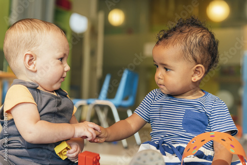 Babys playing together. Poster