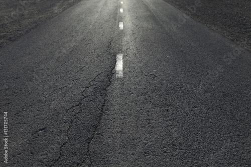 Poster Sunny countryside straight asphalt road detail.