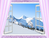 white windows with views of the peaks of snowy mountains