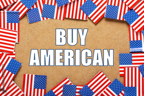 The words Buy American surrounded by flags of the United States of America as a Poster