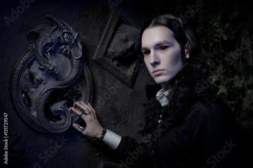 dark goth vampire stylish man in the black studio Poster