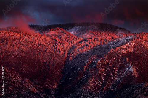 Snowy winter sunset over Mount Lemmon in the Santa Catalina mountains плакат